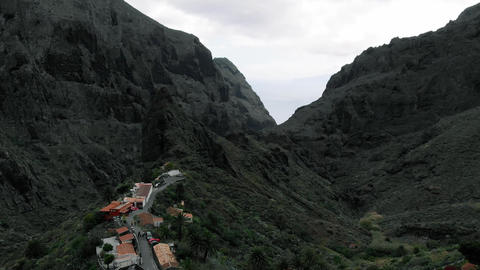 Little village in the gorge in the mountains, aerial view. Masca, Tenerife Footage