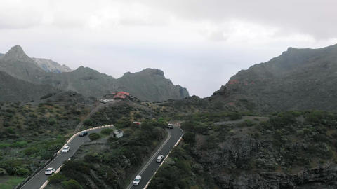Top view of the turn in the mountains, which drive cars. Difficult serpentine Footage