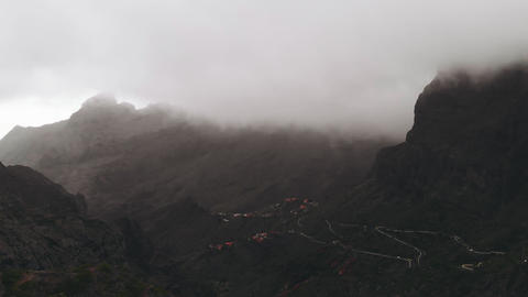 Panoramic aerial view of a canyon in the mountains in cloudy weather. Low clouds Footage