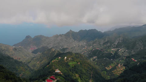 Strong wind high in the mountains, aerial view of the valley and small villages Footage
