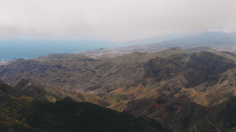 Aerial view - panoramic view of a green valley in a tropical climate. The bird Footage