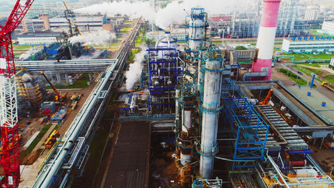 gas and oil refinery complex with production tower aerial Footage