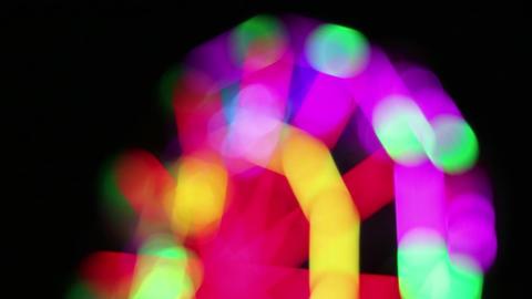 Blurred colorful Ferris Wheel at night fun fair Footage