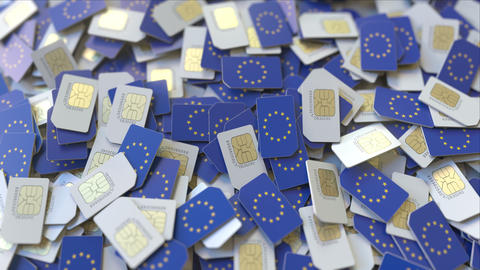 Multiple SIM cards with flag of the EU. European mobile telecommunications Footage