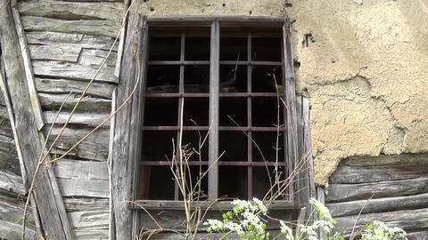 An old window with bars on the abandoned house Footage