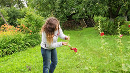 Young woman checking on garden farm apple tree and red currant bush Footage