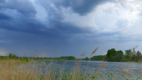 timelapse with storm clouds moving over lake, 4k Footage