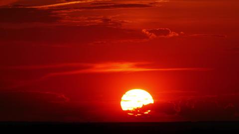 dramatic red sunrise on dark cloudy sky Footage