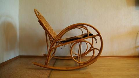 elegant wicker rocking chair sways in the room Footage