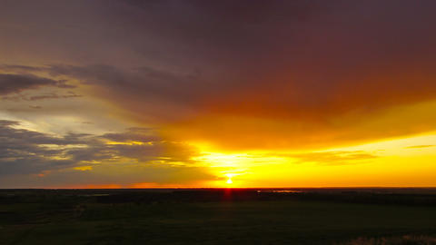 sunset at countryside fields, zoom in timelapse Footage
