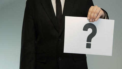 Businessman shows printed question and check mark Footage