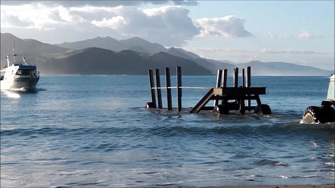 Fishing boat approaches submerged trailer Footage