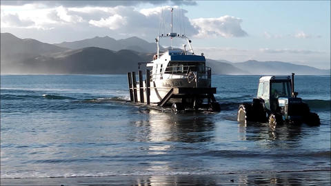 Fishing boat enters submerged trailer Footage