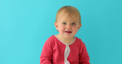 Happy toddler girl over blue background Live Action