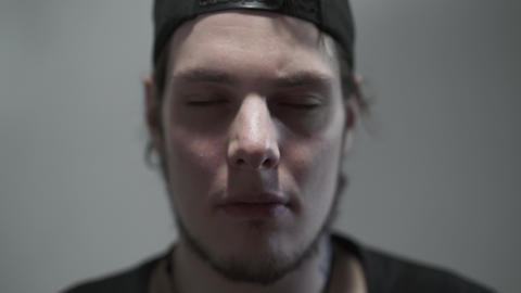 Face of a meditating man with his eyes closed close-up. Spirituality, magic Live Action