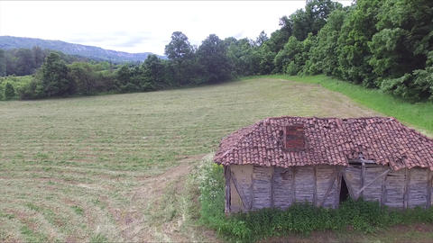 Flight above old and abandoned huts in the middle of the meadow Footage
