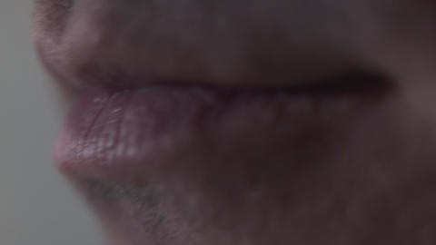 Male chewing lips close-up. Part of face Live Action