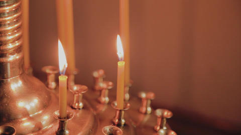 Burning church candles on a candlestick during church services Footage