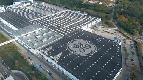 Logo of GENERAL ELECTRIC on the roof of an industrial facility, conceptual Live Action
