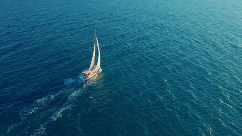 Sailboat in the ocean. White sailing yacht in the middle of the boundless ocean Live Action