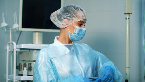Nurse in the operating room assists the doctor Live Action