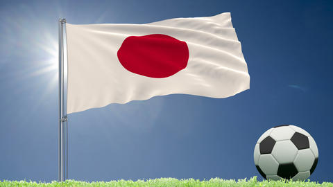 Flag of Japan fluttering and a football rolls on the lawn, 3d rendering, 4k footage Animation