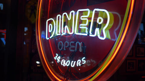 Neon sign Diner 24 hours at Nashville Broadway - NASHVILLE, UNITED STATES - JUNE Live Action