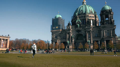 Unknown people near Berlin Cathedral or Berliner Dom, and distant TV Tower Footage