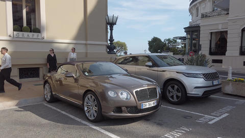 Luxury English Cars Parked In Front Of Monte-Carlo Casino In Monaco Footage