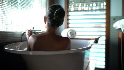 Luxury bath woman relaxing in hot bathtub in hotel resort… Stock Video Footage