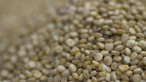 Quinoa seeds falling into a pile of quinoa Footage