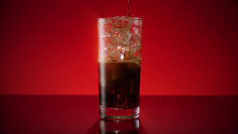 Cola Soda Pouring in Ice Water Star Filter Footage