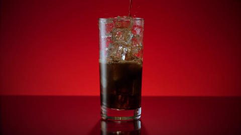 Cola Soda Pouring in Ice Water Footage