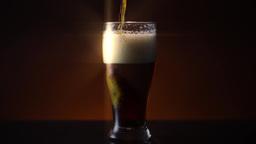 Dark Amber Beer in Pilsner Glass Star Filter Live Action