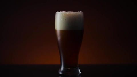Dark Amber Beer in Pilsner Glass Live Action