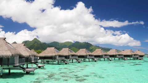 Travel vacation paradise with overwater bungalow resort hotel in coral reef sea Footage