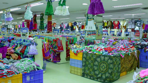 Interior of kids store. Shop of women's clothing. Women's panties on hangers in a store Live Action