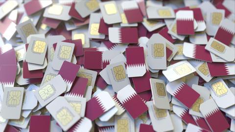 Multiple SIM cards with flag of Qatar. Qatari mobile telecommunications ビデオ