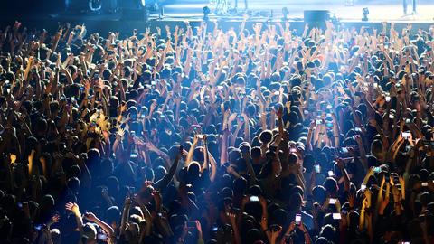joyful crowd enjoys listening famous group rock concert Footage