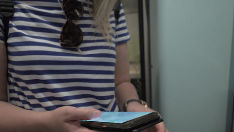 Woman looking at map on cellphone during subway ride Live Action