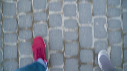 Top view of male and female legs strolling along the sidewalk Footage