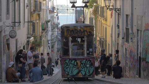 Old graffiti painted tramway in Lisbon street, Portugal Footage