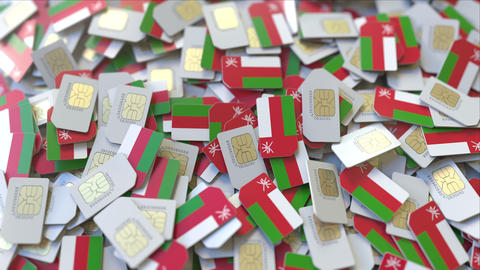 Multiple SIM cards with flag of Oman. Omani mobile telecommunications conceptual ビデオ