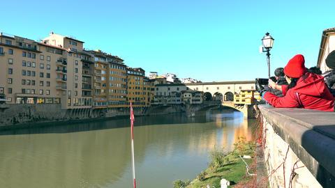 Unknown tourists make photos of famous Ponte Vecchio bridge in Florence, a major Footage