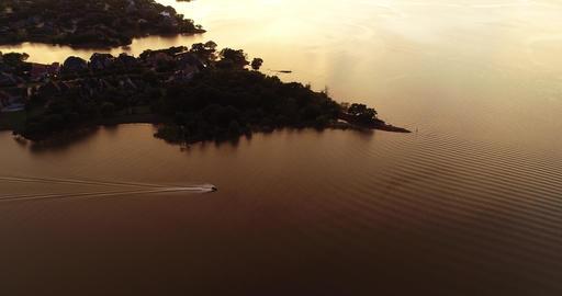 Colorful sunset and lake reflection with Jetski Archivo