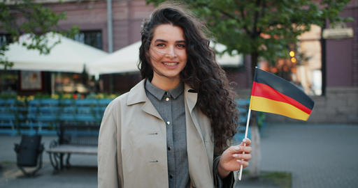 Slow motion portrait of German patriot standing outdoors with flag of Germany Footage