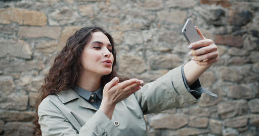 Slow motion of beautiful girl taking selfie outdoors with smartphone camera Footage
