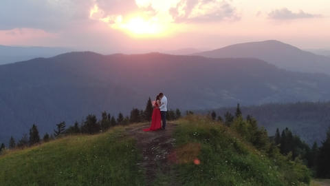 Couple in love embrace and enjoy intimate moment together sky background Live Action