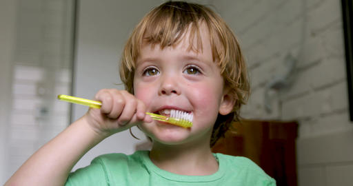 Little blond boy learning brushing his teeth Footage