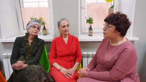 Elderly women sit and talk on friend meeting in pensioners' club Footage